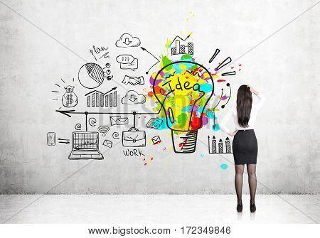 Rear view of a businesswoman scratching her head and standing near a concrete wall looking at a colorful bright business idea sketch depicted on it.