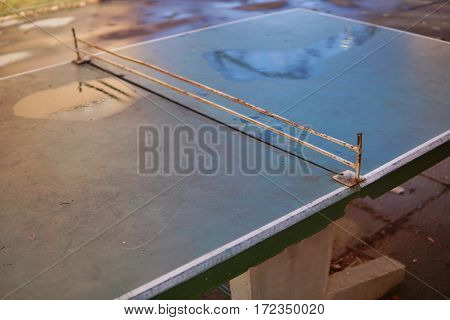 Abstract detail of old ping pong (table tennis) table placed in the middle of aged housing project as a symbol of sport activities placed in older districts