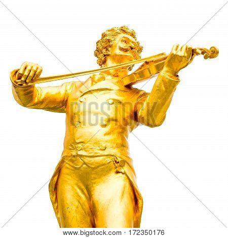 Statue close up view of gilded bronze monument of Johann Strauss in Vienna, Austria
