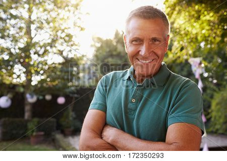 Portrait Of Mature Man In Back Yard Garden