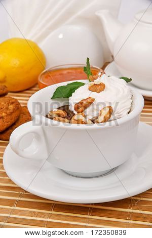 Hot Chocolate With Whipped Cream And Walnuts, Decorated With Mint Leaves In A White Cup On A Decorat