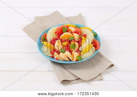 plate of fruit salad on beige place mat