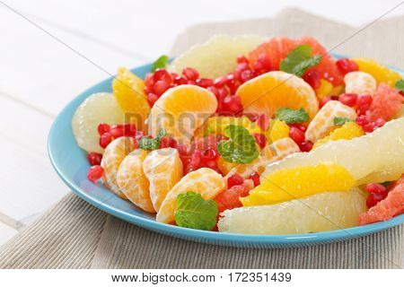 plate of fruit salad on beige place mat - close up