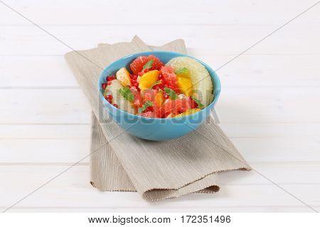 bowl of fruit salad on beige place mat