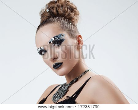 beautiful girl with make-up posing on a white background in studio