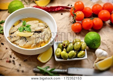 Herring fillets in oil - healthy and tasty meal on table