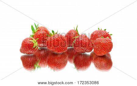 ripe strawberries closeup on white background with reflection. horizontal photo.