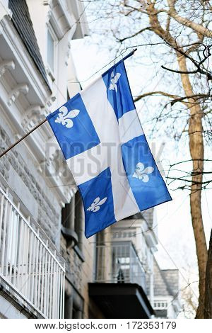 Quebec Flag In Montreal Billowing In The Breeze