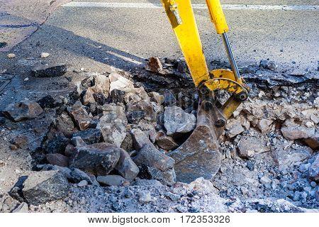 Working mini excavator Tractor Digging street city