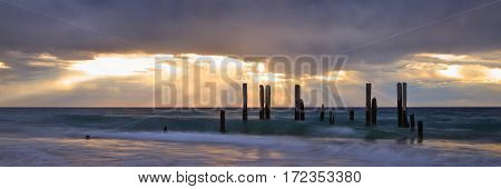 The pylons are all that remains of the Port Willunga jetty on the coast of South Australia, a short drive south of the state capital, Adelaide. - South Australian landscapes.