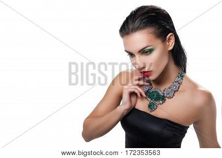 Fashion photo of young magnificent woman posing at studio