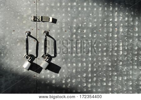 Close up Padlocks with old iron gate background with shade and shadow from sunlight. Copy space.