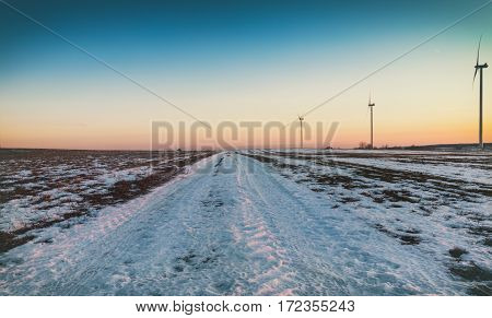 Wind Power Turbines  Farm in Rural Wintry Landscape