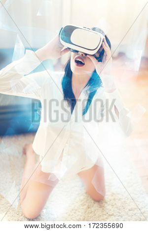 Sexy brunette woman in shirt and VR glasses enjoying virtual reality