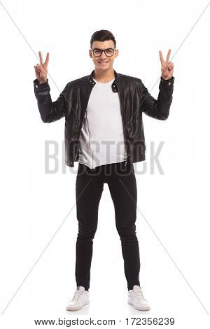 happy young man maing the victory sign isolated on white background