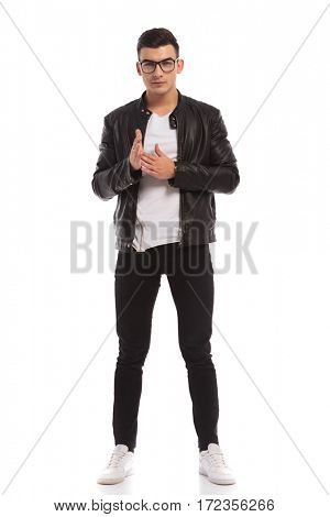 full body picture of a young man rubbing his palms together on white background