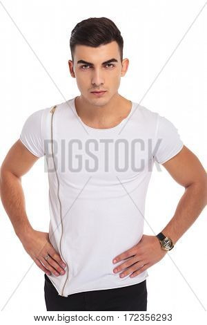fit young casual man standing with hands on waist isolated on white background