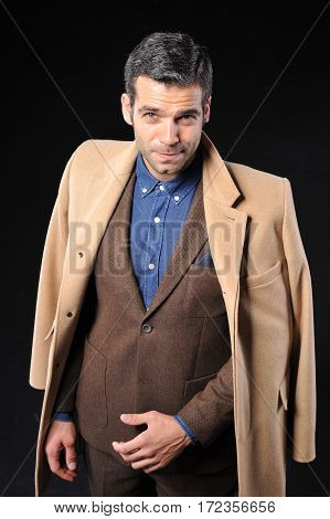 young business man wear brown suit on black background