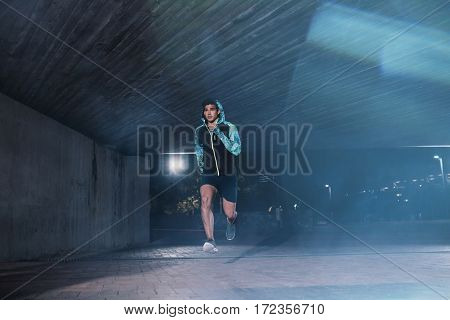 Young Sportsman Jogging In The Night
