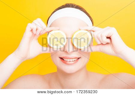 Closeup Of Cheerful Woman Holding Slices Of Orange