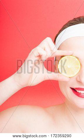 Half Portrait Of Beautiful Woman With Lemon
