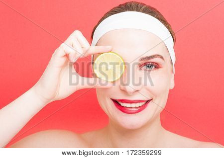 Woman With Clean Face Holding Slice Of Lemon