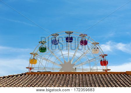 Brown roof ferris wheel and blue sky day view
