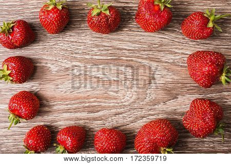 Frame from a red ripe strawberry. Summer ripe berries. Space for text and design. Top view