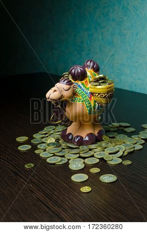 saving the money in to the coin bank. money box camel