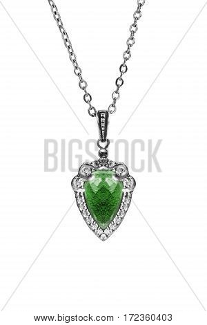 Green emerald pendant on silver chain isolated over white