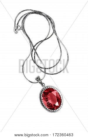 Large ruby medallion on a chain isolated over white