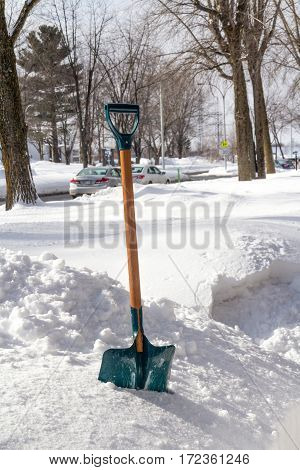 view of a winter shovel on the frontyard of a residential street of Sorel-Tracy in Quebec Canada
