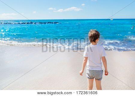 Happy 7 Years Boy Child Walking On The Beach.