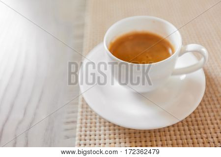 Hot Coffee In White Cup On Vintage Wooden Table
