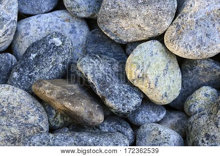 Pebbles on the beach close up.Stone background.Stones texture.Selective focus.