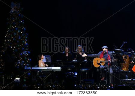 BROOKLYN, NY-DEC 9: Sarah McLachlan (L) and James Taylor perform at WCBS-FM 101.1's Holiday in Brooklyn at Barclays Center on December 9, 2016 in Brooklyn, New York.