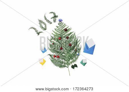 Christmas card 2017. Green fern red cherries small colored envelopes and cornflower are isolated on a white background.