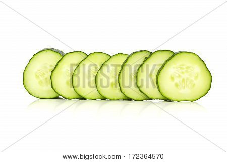 Cucumber slices line up, over a white background.