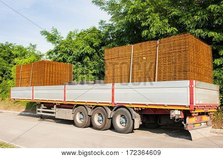 Wire nets for building loaded on a truck trailer.