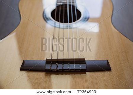 Guitar on wooden background fretboard, music instrument