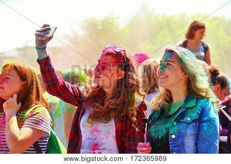TULA RUSSIA - JUNE 13 2016: Two young girls doing selfie at festival of colors Holi on June 13 2016 in Tula Russia