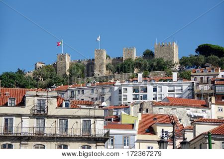 Sao Jorge Castle (Saint George Castle) is a Moorish castle occupying a commanding hilltop overlooking the historic centre of Lisbon Portugal. The strongly fortified citadel dates from medieval period of Portuguese history and is one of the main tourist si