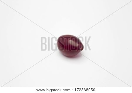 One Juicy Plum On A White Background