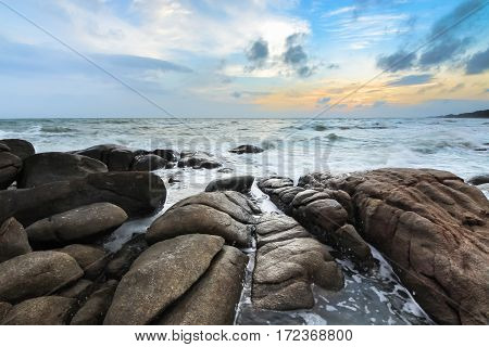 Rocky beach in twilight time before the sunset