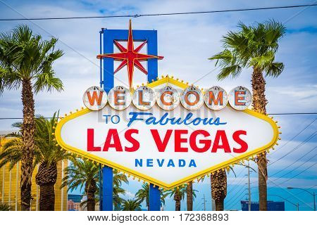 Classic view of Welcome to Fabulous Las Vegas sign at the south end of world famous Las Vegas strip on a beautiful sunny day with blue sky and clouds Las Vegas Nevada USA