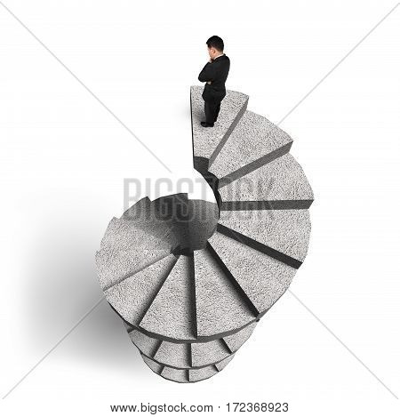 Businessman Standing On Concrete Spiral Staircase