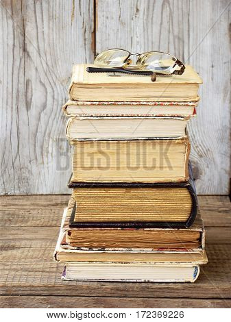 Stack Of Old Hardback Books On Wooden Background. Selective Focus