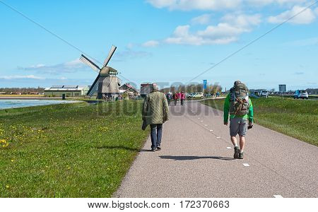 Zijpe, Netherlands - May 1, 2016: participants in the organized walk Flowering Zijpe in the head of the province Noord-Holland in The Netherlands.