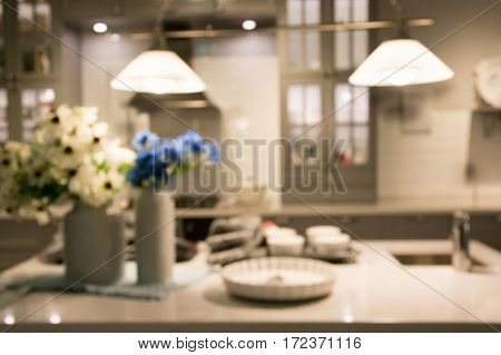 Blurred background. Modern kitchen with tabletop with decor prepare for cooking and space for you.