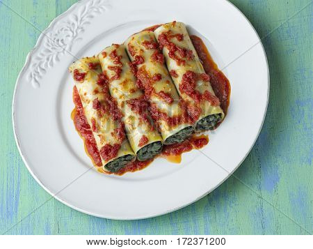 close up of rustic italian vegetarian spinach cannelloni pasta